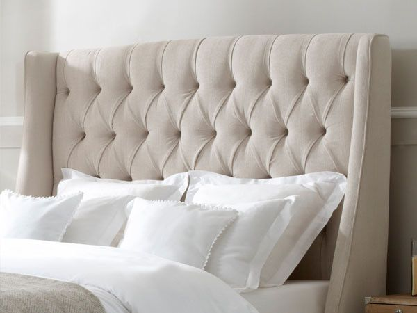 Traditional King Size Headboard With White Comforter And Cushions