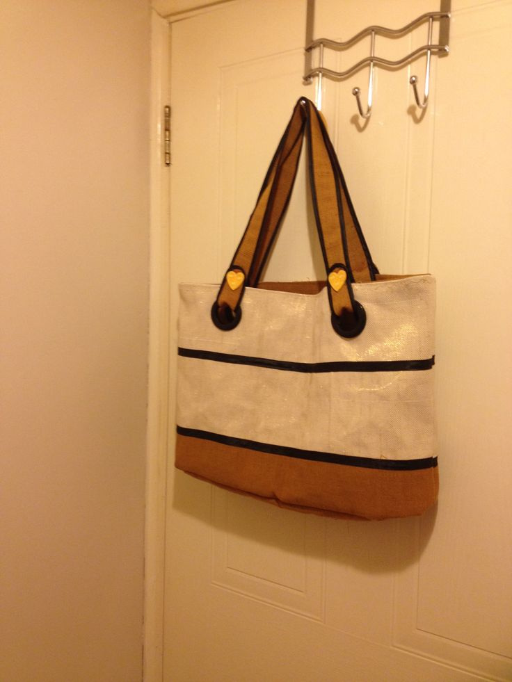 Another tote bag in gold-threaded cream and brown made from Nigerian Aso-oke with eyelet handles