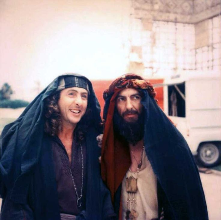 Eric Idle and George Harrison on the set of Life Of Brian.