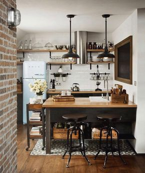 Small kitchen with solid details; Brick, wood floors, SMEG fridge.