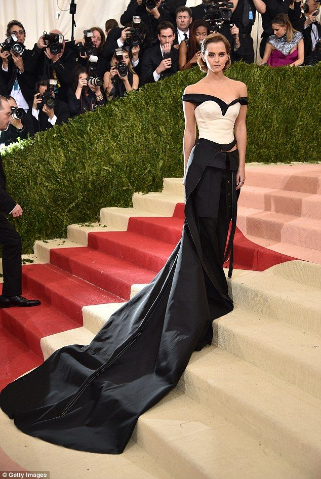 Quirky: She went for an off-beat choice with her billowing black trousers that featured a ...