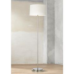 Sleek, urbane and cosmopolitan, this floor lamp makes an elegant addition to your home's décor.