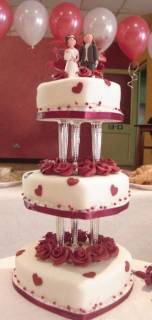heart shaped wedding cakes in white and red flowers decor