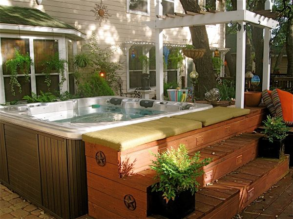 Backyard hot tub and deck construction!  via http://twelveoaksmanor.com