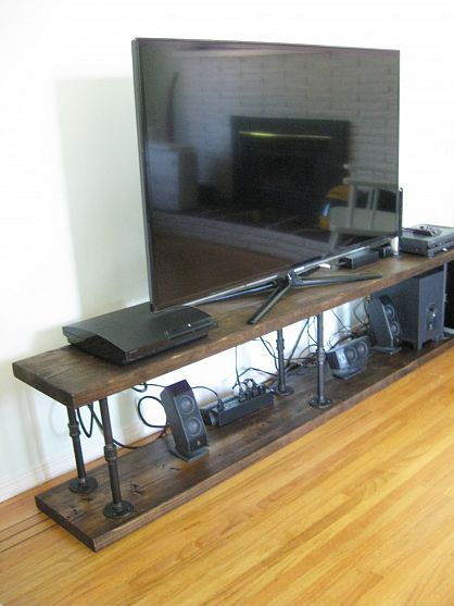 TV stand. This could use some cord-hiding feature.
