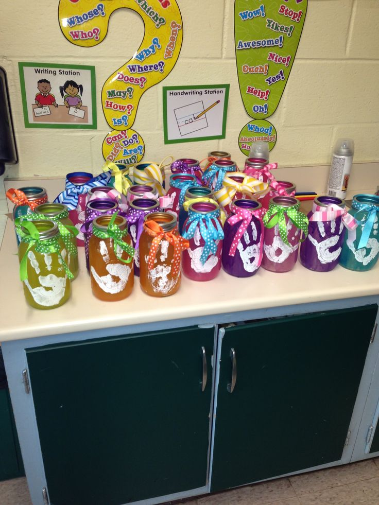 Great craft for moms day made by my first grade class. The colors came out great and bright. The kids loved making them.  Mix Elmer's glue with food coloring and paint on the jar. Let dry. Then put handprint on. Dry. Use clear coat to make shinny and protect it from water.  What fun!!!