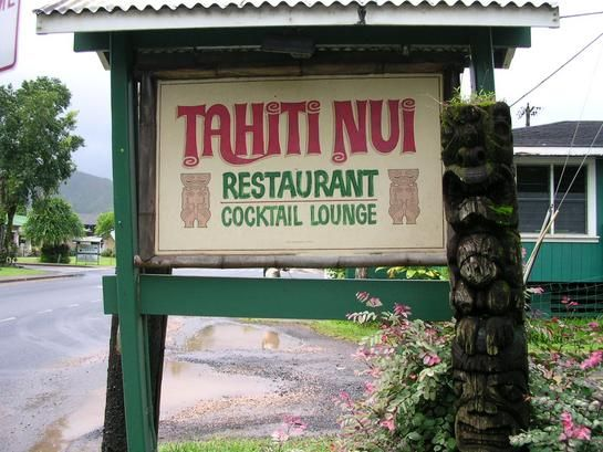 Tahiti Nui, Hanalei, Kauai, Hawaii.   Great tiki bar, usually with live music. Food is just ok, but should definitely stop in for a drink.