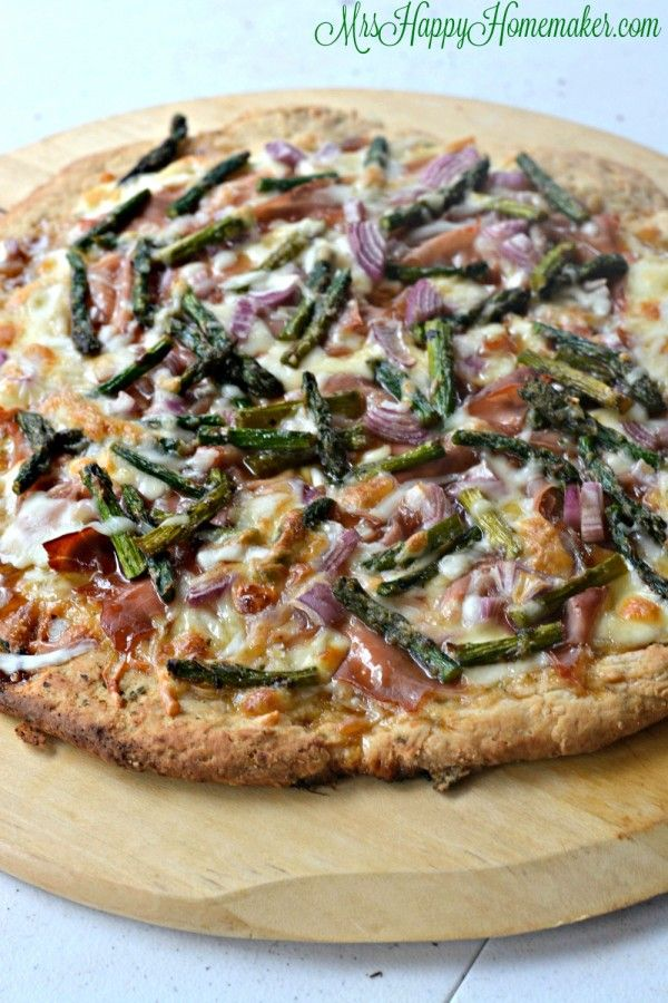 Sweet & salty with the balance of caramelized onions & prosciutto  - and absolute perfect. This is my family's FAVORITE pizza. It's oh-so-good. You're going to be shocked at how easy it is too! | MrsHappyHomemaker.com @thathousewife