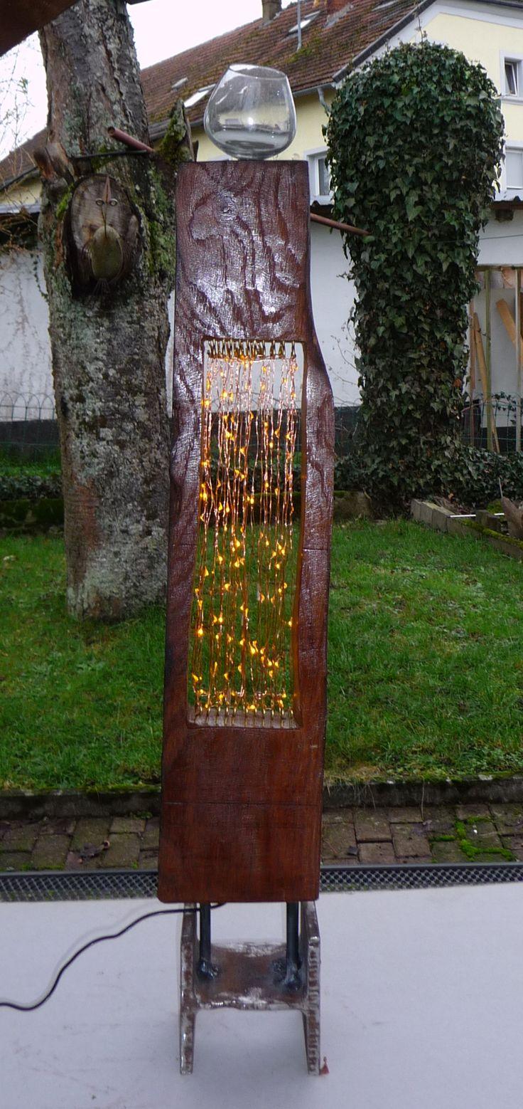 Buchenholz mit LED-Kette und Cognacschenker mit Doppel-T-Trägerfuß