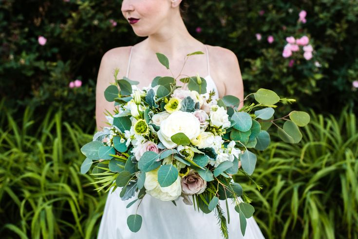 A trend-setting combination of garden flowers and cascading foliage create this remarkable bouquet.