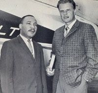 From the mid-1950s on, Graham became increasingly opposed to segregation and racism, while keeping his eye on public opinion. For instance, in 1957 he invited Rev. Martin Luther King, Jr. to join him in the pulpit at his 16-week revival in New York City, where 2.3 million gathered at Madison Square Garden, Yankee Stadium, and Times Square to hear them. Graham never appeared publicly again with King, but he posted bail for the minister to get him released from jail in 1963