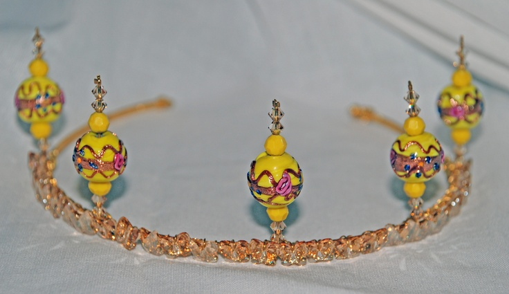 this tiara on Tiaraboomdeaye.co.uk is adorned with Swarovski crystal butterflies and bicones, with round Venetian glass beads in vivd yellow.