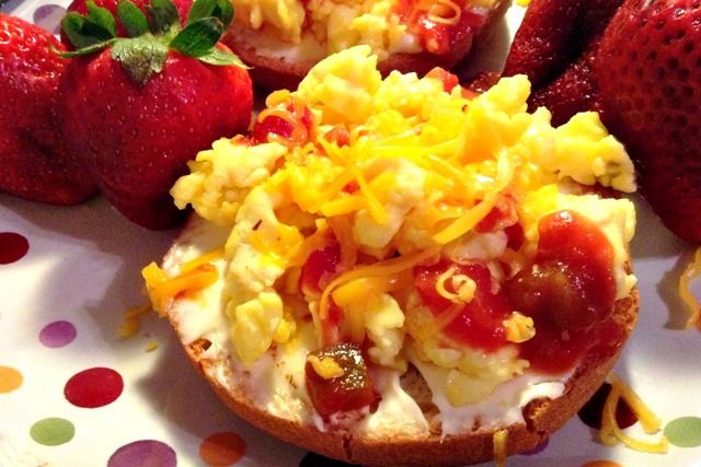 Spread a bagel with cream cheese and top with scrambled eggs, salsa, and cheddar. LOTS of other ideas here too.