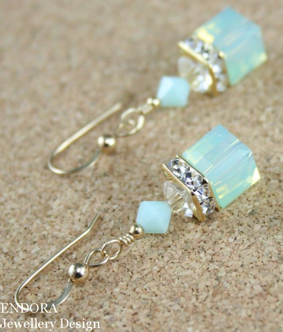 Swarovski earrings,cube earrings,mint earrings,swarovski mint earrings,crystal earrings,swarovski crystal earrings,gold mint earrings,cube ♥ Swarovski crystals featuring 8mm Cube in Mint green opal ♥ 14K Gold filled earwires and findings. ♥ Earring measures 38mm/1.5inches from the top of the earwire. ♥ Available in sterling silver - please select from available options. ♥ To save on shipping costs your item will be packaged on a presentation card enclosed in a velvet pouch and safely and…