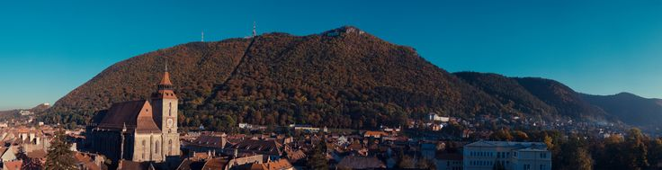 Old city center of Brasov, Romania.  Black Church, iconic building of Brasov, on the left side dominating the old neighborhood.  Tampa mountain it's also a symbol of Brasov, even if it's just a bigger hill and not a mountain :)  #Brasov #Transylvania #Romania #autumn #Tampa #BlackChurch