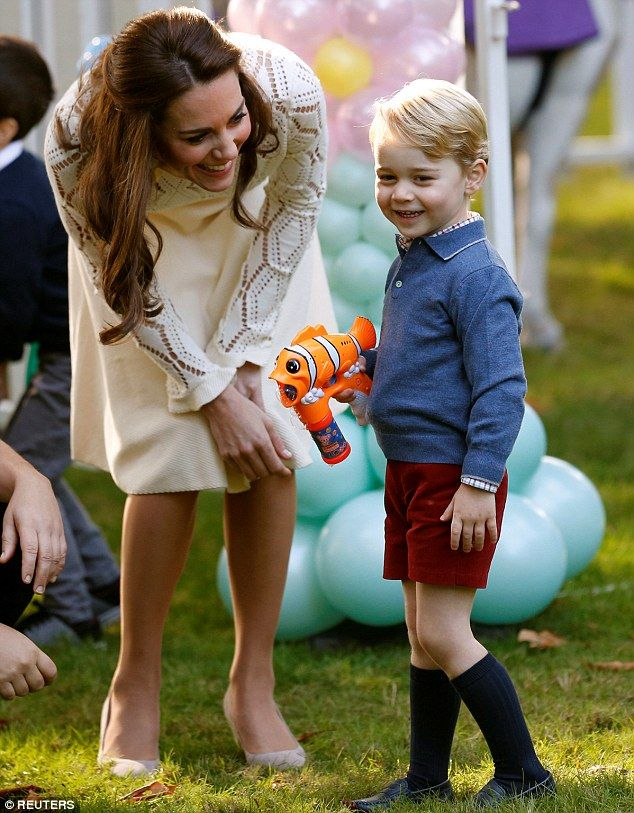 Prince George has fun with a bubble gun at achildren's party at Government House in Victo...