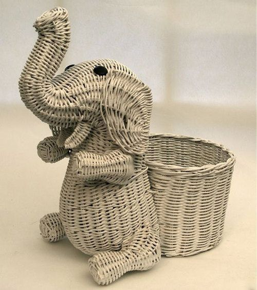 Most popular tags for this image include: animal, basket, elephant, white and wicker