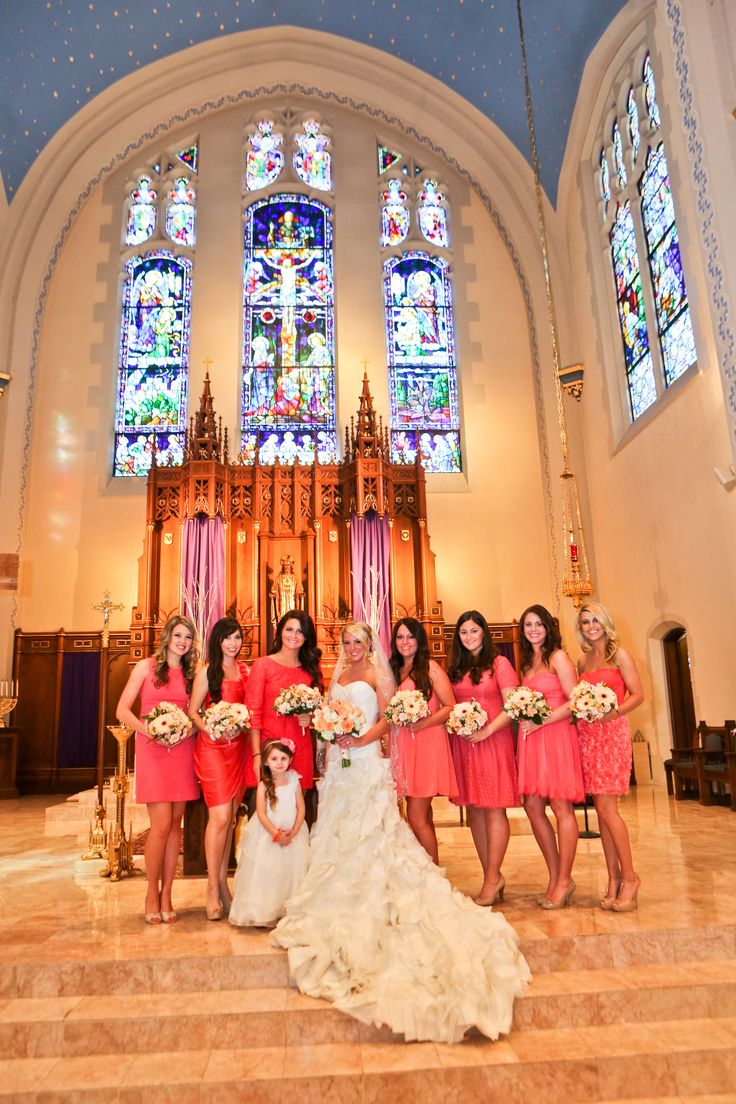 Mismatched bridesmaids dresses in shades of Coral #bridesmaids #dresses #coral
