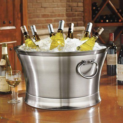 """Optima Beverage Tub - Brown, 21"""" - Frontgate by Frontgate. $169.50. Double-walled 18/8 stainless steel allows a layer of air to function as the insulator. Both tub sizes leave ample room for ice and drinks. Optional stand beautifully displays either the 21"""" or 17"""" beverage tub. Bottle Opener (sold separately) hangs from the tub's side for easy access. Sturdy, hinged handles with a secure stop facilitate lifting and carrying. Double-walled 18/8 stainless steel allows a lay..."""