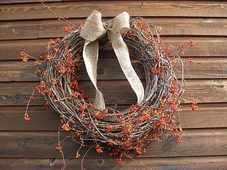 beautiful bittersweet wreath with a burlap bow