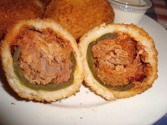 Armadillo egg from Texas restaurant. Pickled Jalapeno stuffed with sweet tender barbeque brisket. Deep fried in egg, flour coating. mmm Only @ T-Bone Tom's Steakhouse Restaurant - Kemah, TX
