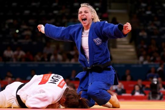 Automne Pavia of France celebrates her bronze medal over Hedvig Karakas of Hungary during the Women's -57 kg Judo.