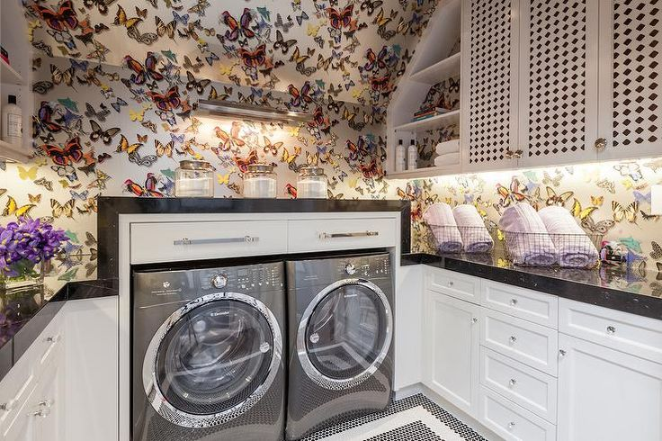 amazing laundry room features ceiling and walls clad in christian lacroix butterfly parade. Black Bedroom Furniture Sets. Home Design Ideas