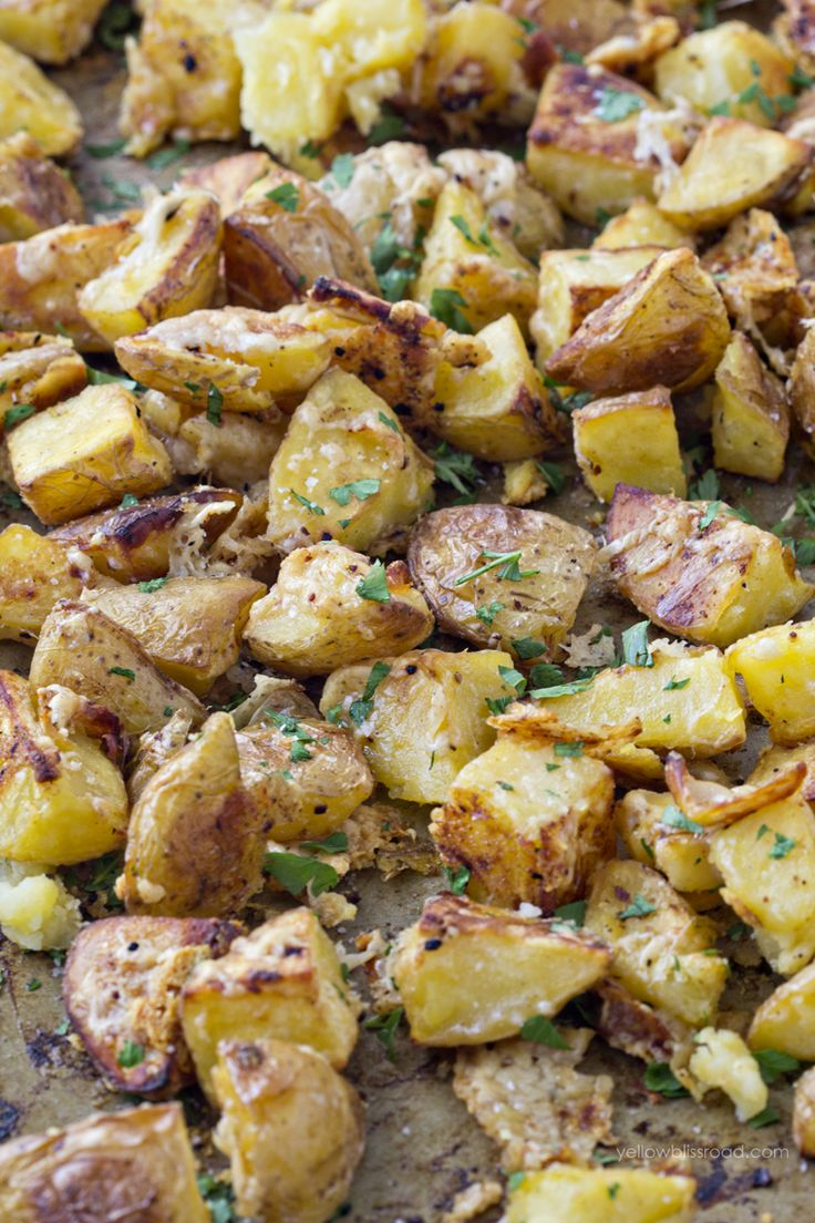 Roasted Garlic Parmesan Potatoes:3 lbs Yukon Gold potatoes (chunks) 3 Tbsp olive oil,1 Tbsp white vinegar,4 garlic cloves, minced,1 Tbsp kosher salt,1 tsp pepper, 5 oz grated Parmesan cheese,2 Tbsp chopped parsley.In bowl, whisk olive oil,vinegar,garlic,salt,pepper.Toss potatoes til coated.Roast in 425 oven 35-40 minutes, turning once.Remove from oven.Sprinkle cheese over potatoes,stir to coat.Place potatoes back in oven 10-15 mins,til cheese is crisp.Sprinkle with parsley,serve immediately.