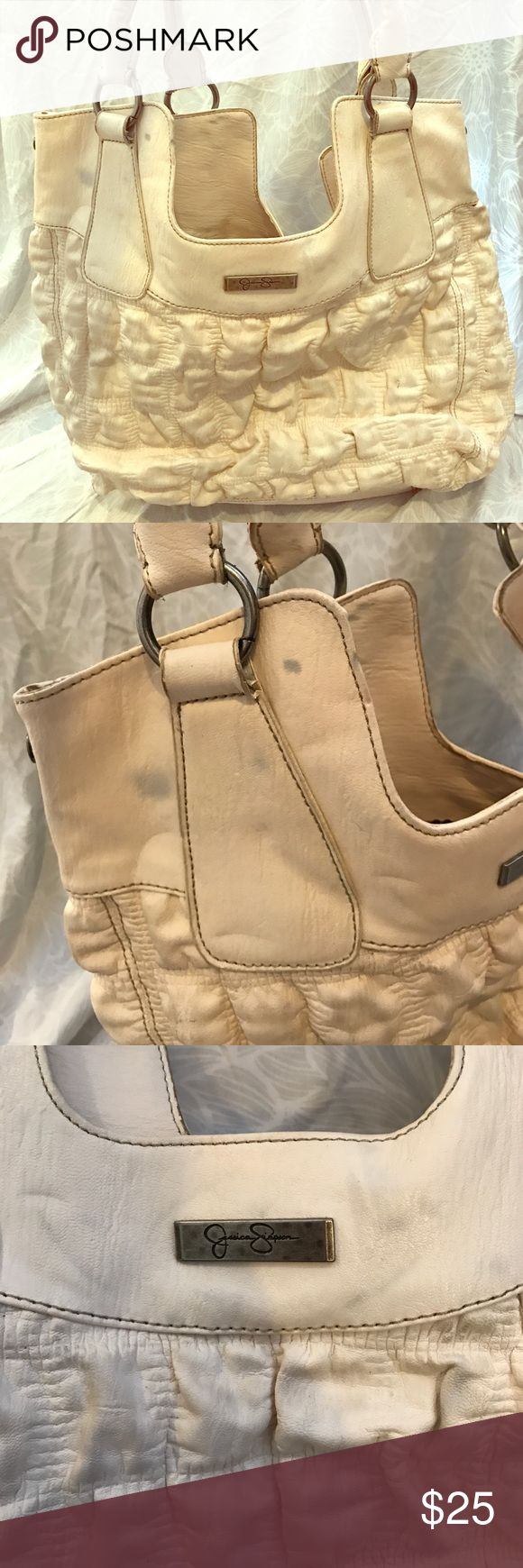 Jessica Simpson handbag Pre loved off-white Jessica Simpson handbag, needs a good wipe down. Inside is in PERFECT condition! Please note: there are very light blue stains from the bag rubbing on jeans when being carried. Price reflects this! Jessica Simpson Bags Totes