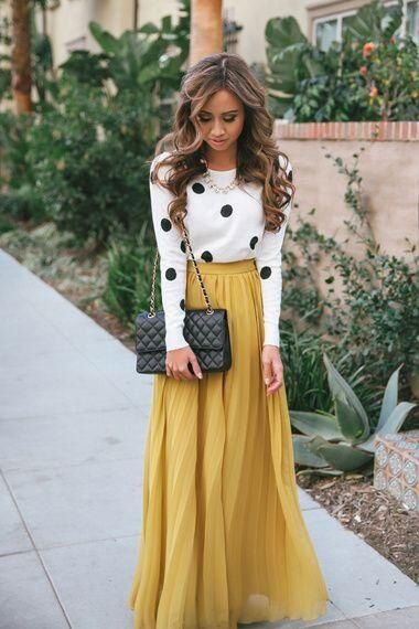 tuck a pretty sweater into a colorful maxi skirt for a more sophisticated look. a statement necklace adds some glamour