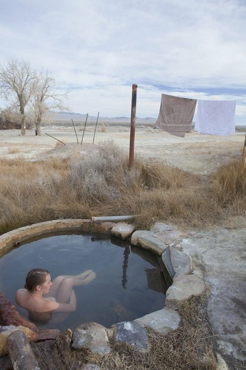 By oneself in hot tub.