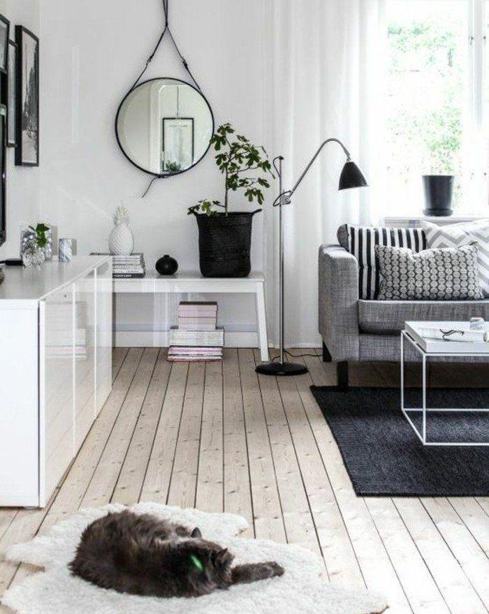 superbe deco salon blanc avec des accents gris, canapé gris, tapis couelur gris anthracite, parquet en bois, ambiance calme, salon style scandinave