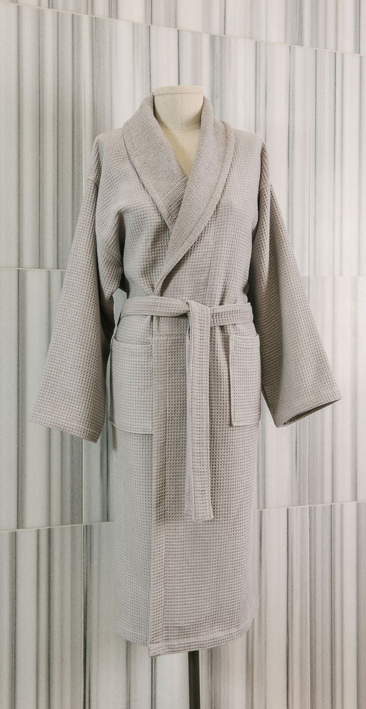 Our Waffle/Terry robe is a light-weight, reversible design made from 100% pure Turkish cotton.  Loomed to a 350 gsm weight, the robes combine waffle and terry fabric to make a versatile and irresistibly comfortable garment. Featuring a shawl collar, the robes have a two pocket design and a two-loop belt.   - See more at: http://www.talesma.com/eng/93/talesma--waffle/terry-shawl-collar-robe.html#sthash.cHTOCz14.dpuf