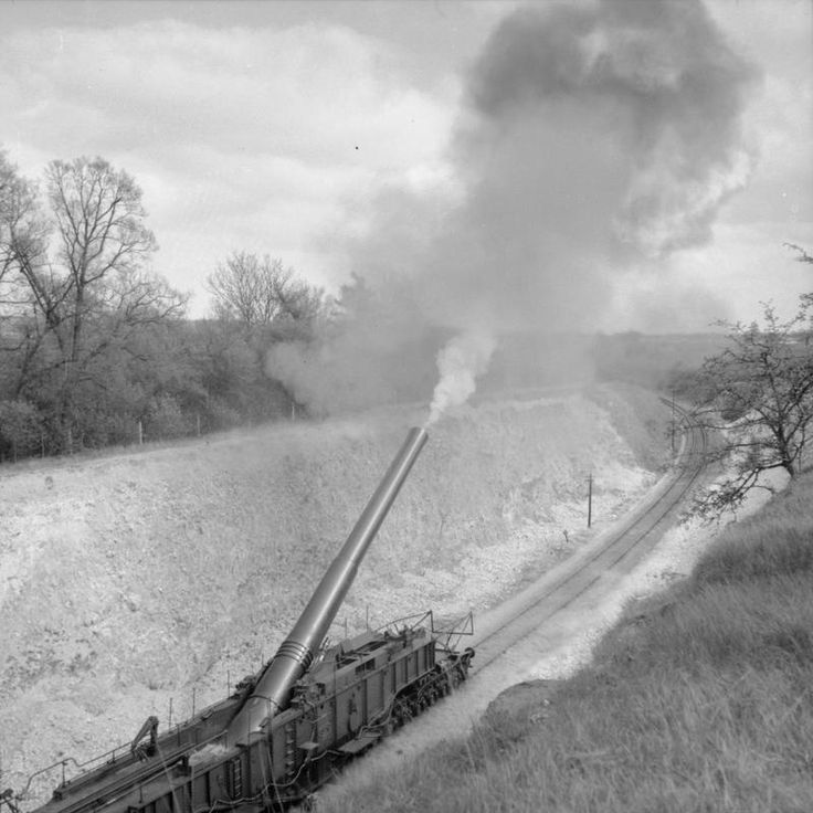 Like the Germans, the British had a number of long-range railway guns that could fire across the English Channel. The photo shows the 18-inch railway gun 'Boche-Buster' firing from a cutting near Bishopsbourne in Kent, 7 May 1941.