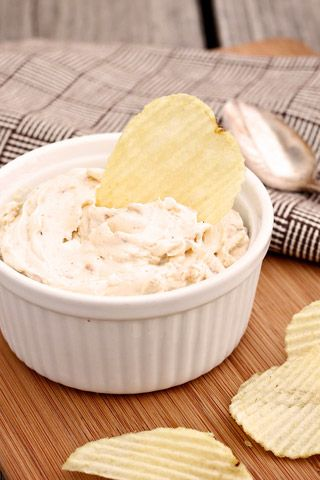 Clam Dip Recipe - Yankee Magazine:  I used two 8 oz tubs light cream cheese, about 1/2 cup sour cream, a 10 ounce can of Bumblebee Baby Clams, some dried onions and onion and garlic powder.  It was a little too soupy so added about 1/3 cup parmesan and microwaved for 30 second, then 30 more.  Can be served cold, warm or room temperature.