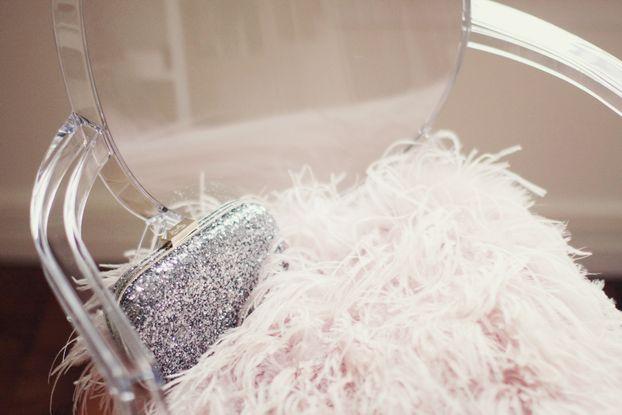 Stark for kartel chair - Anya Hindmarch clutch - Topshop feathers bolero