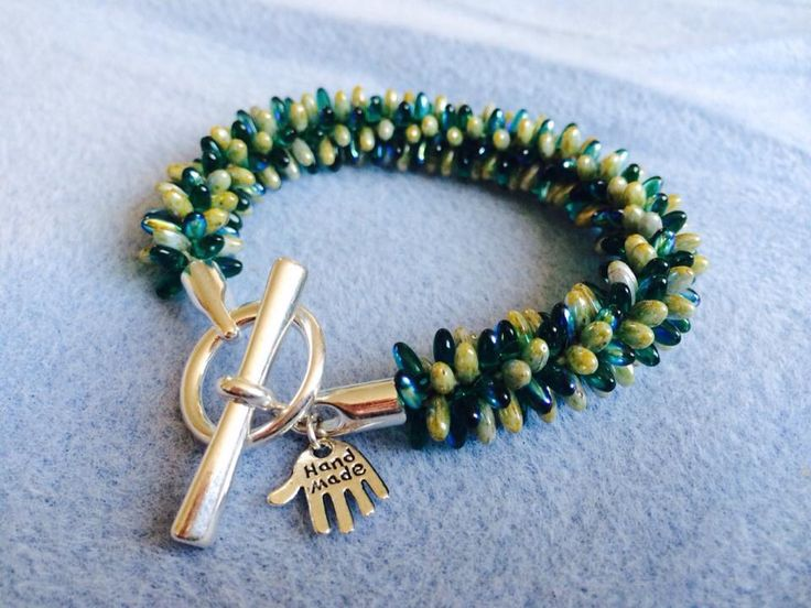Dark and light green with a chunky clasp
