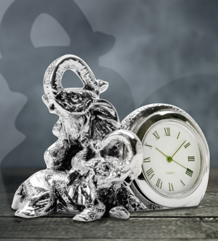 Table Clock Elephant - The attractive Baby elephant silver clock is designed in a fashionable way.