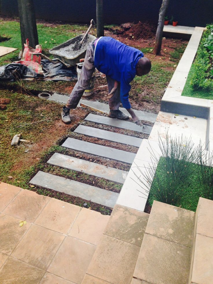 Cement slabs on the lawn on the 2nd terrace - in progress.