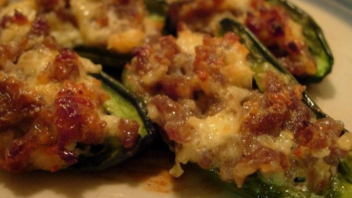 Jalapeno pepper halves are stuffed with cheese and sausage. You will love this spicy appetizer treat!