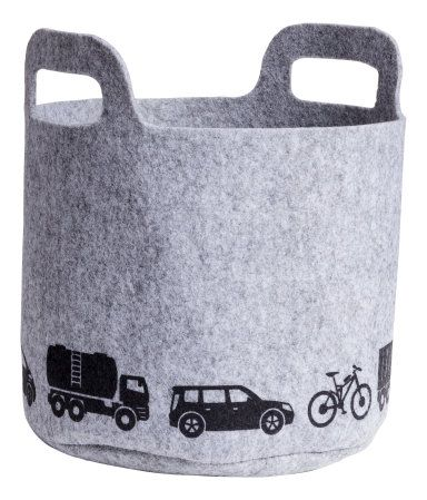 Felted storage basket with handles and a printed motif. Height 7 1/2 in., diameter 8 1/2 in.