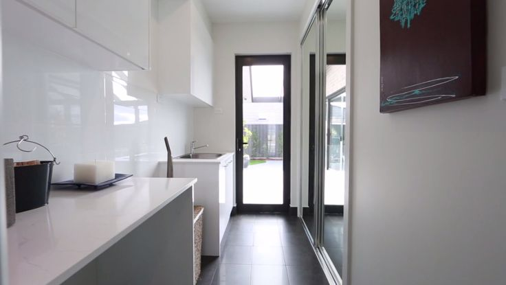 The Laundry! Built in linen cupboard with mirror doors is a great way to create a sense of openness in narrow spaces. The Parklane Display Home by Pavilion Homes #PavilionHomesACT #WeeklyHomeTrends #Laundry #theevolvingspace #clarkaustralia #HomeIdeas #Styling http://www.pavilionhomes.com.au/