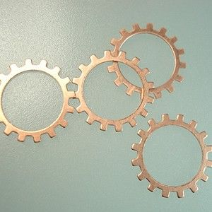 """19mm 24ga Raw Copper Open Gear Approx. 19mm gear link blanks. 14mm inner diameter center hole. 24-gauge (0.02""""/0.508mm). Ready for customizing — great for handmade steampunk jewelry! Solid Copper   Price: 1-11 - 75c each Pack of 12 - $7.50 (62.5c each)"""