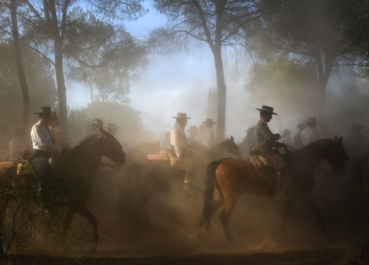 JULY 29, 2017. Spanish pilgrimage  By José Antonio Zamora.  In the small town of El Rocío, in Andalusia, Spain, an annual pilgrimage takes place on the second day of Pentecost. Hundreds of thousands of people from across Spain travel, often on horseback, to worship a small wooden statue of the Virgin Mary. As the tradition dates back to the 1700s, pilgrims usually wear traditional dress for the journey and celebration.