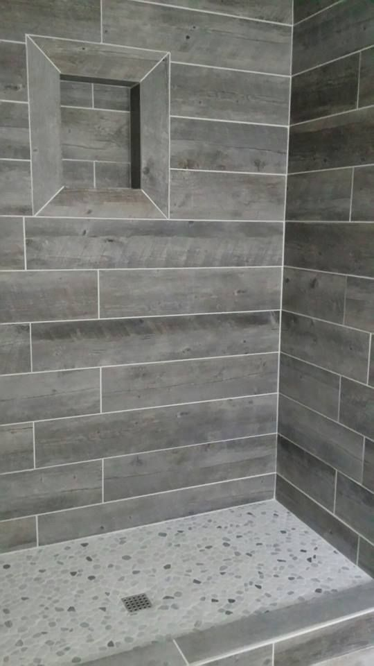 Shower with gray tiles that look like hardwood.  Wood looking tile planks.  #shower #gray #tiles #looklikewood #fauxwood