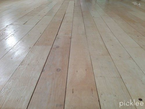 A much cheaper alternative to hard wood floors. White wash wide plank plywood floor.