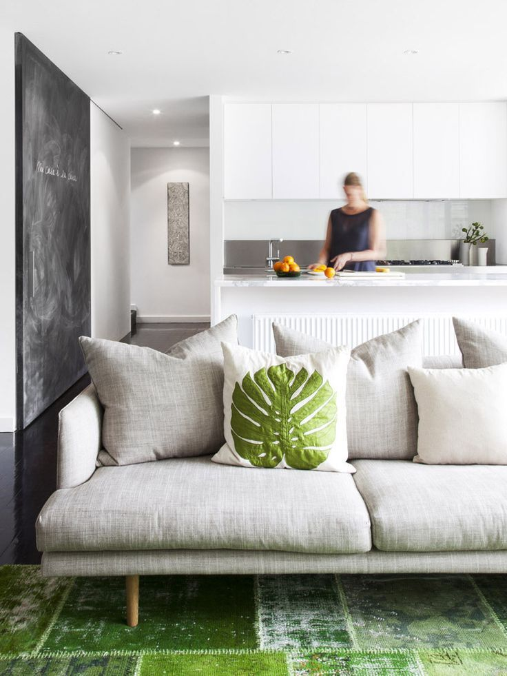 Contemporary Decor With A Beautiful Green Rug And Accent