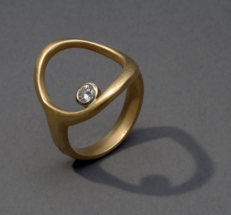 a guiding star ring in 18K gold with diamond. $1,495.00, via Etsy.