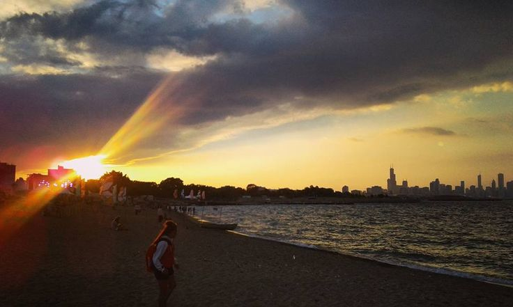Sunset over the Oak Street Beach on the South Side #Chicago. Visit thewhirligig.org to learn more about this beautiful, underrated part of town! #travel #sunset