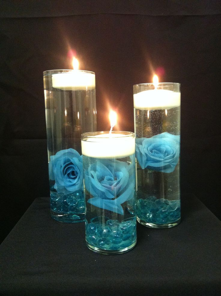 Turquoise Rose And Floating Candles Centerpieces Wedding